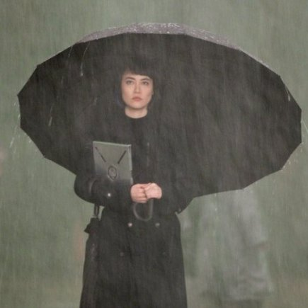 Rinko Kikuchi with another co-star of the film--the rain